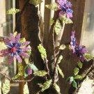 Beaded purple flower on branch