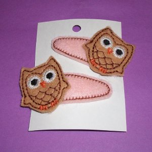 Pair of owl clippies