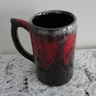 Vintage Pottery Big Beer Mug Lava Drip Red on Dark Brown.