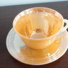 Vintage peach lustre cup & saucer Fire King
