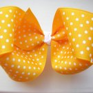 Yellow Gold and White Polka Dot Bow