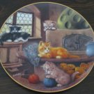 At the Tiled Stove Cat Plate by The Bradford Exchange