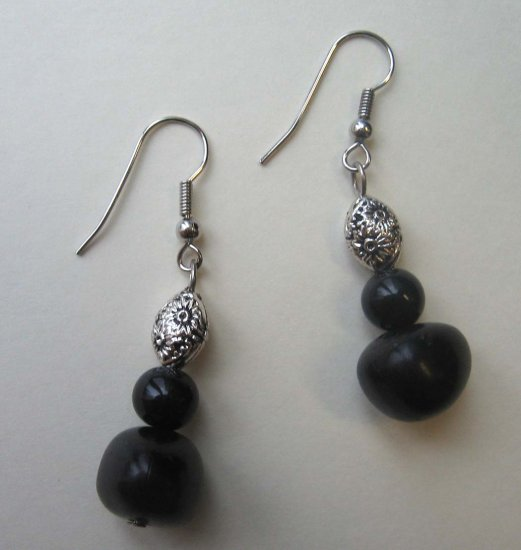 Black wood and silvertone embossed bead drop earrings by Lucine