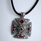 Maltese cross with red crystals