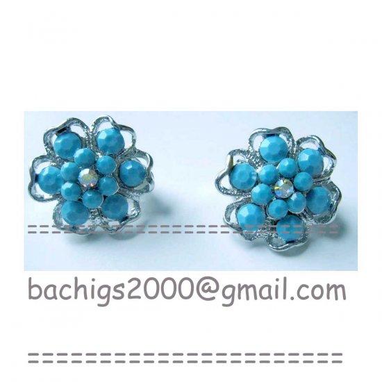 Blue clip on flower fashion earrings {718E}