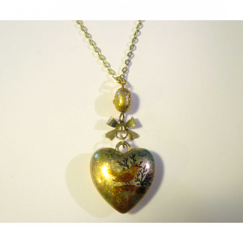 On sale: Gold bird heart pendant