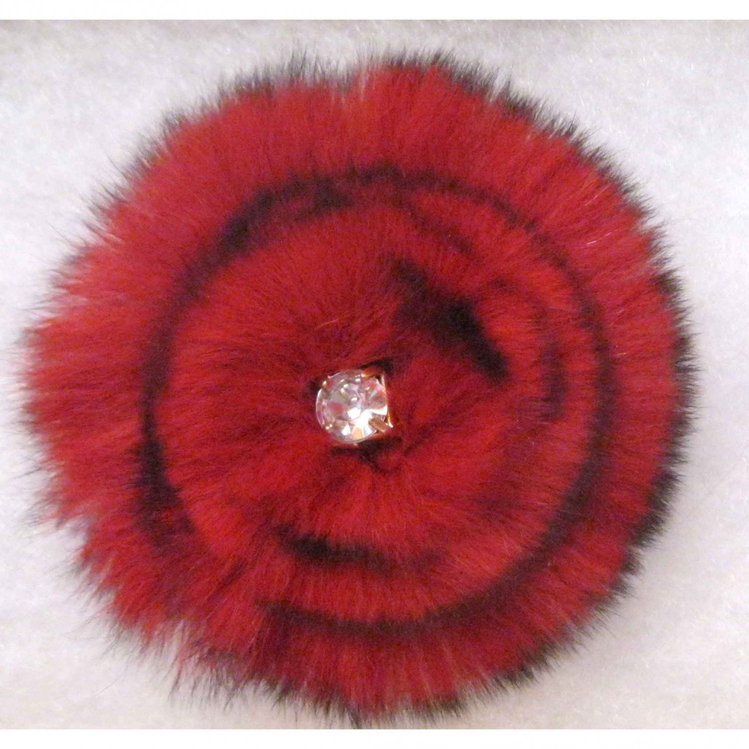 Red faux fur with crystal pin/pendant