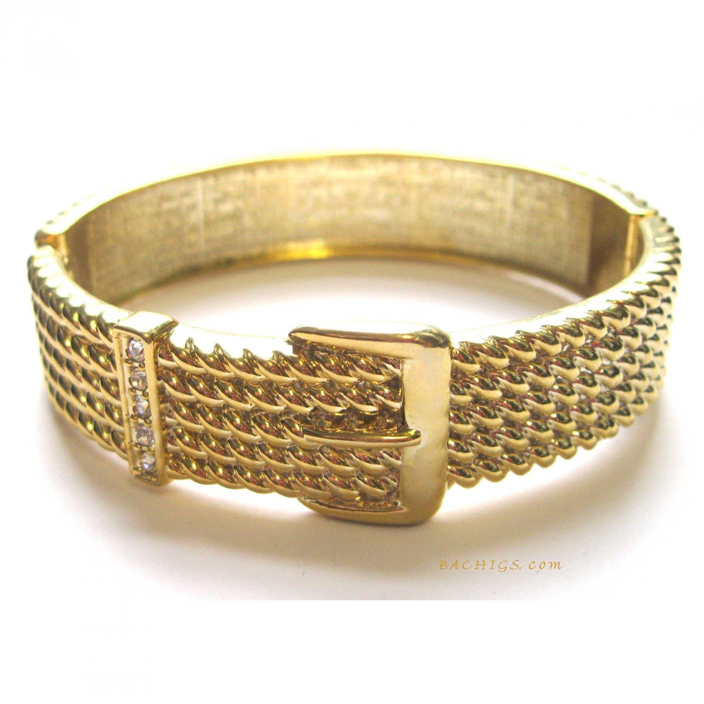 Elegant hinged goldtone bracelet with crystals -
