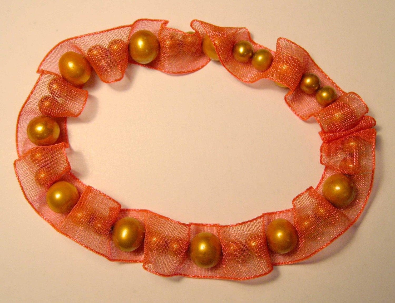 Orange slip on ribbon f.w. cultured pearl fashion bracelet