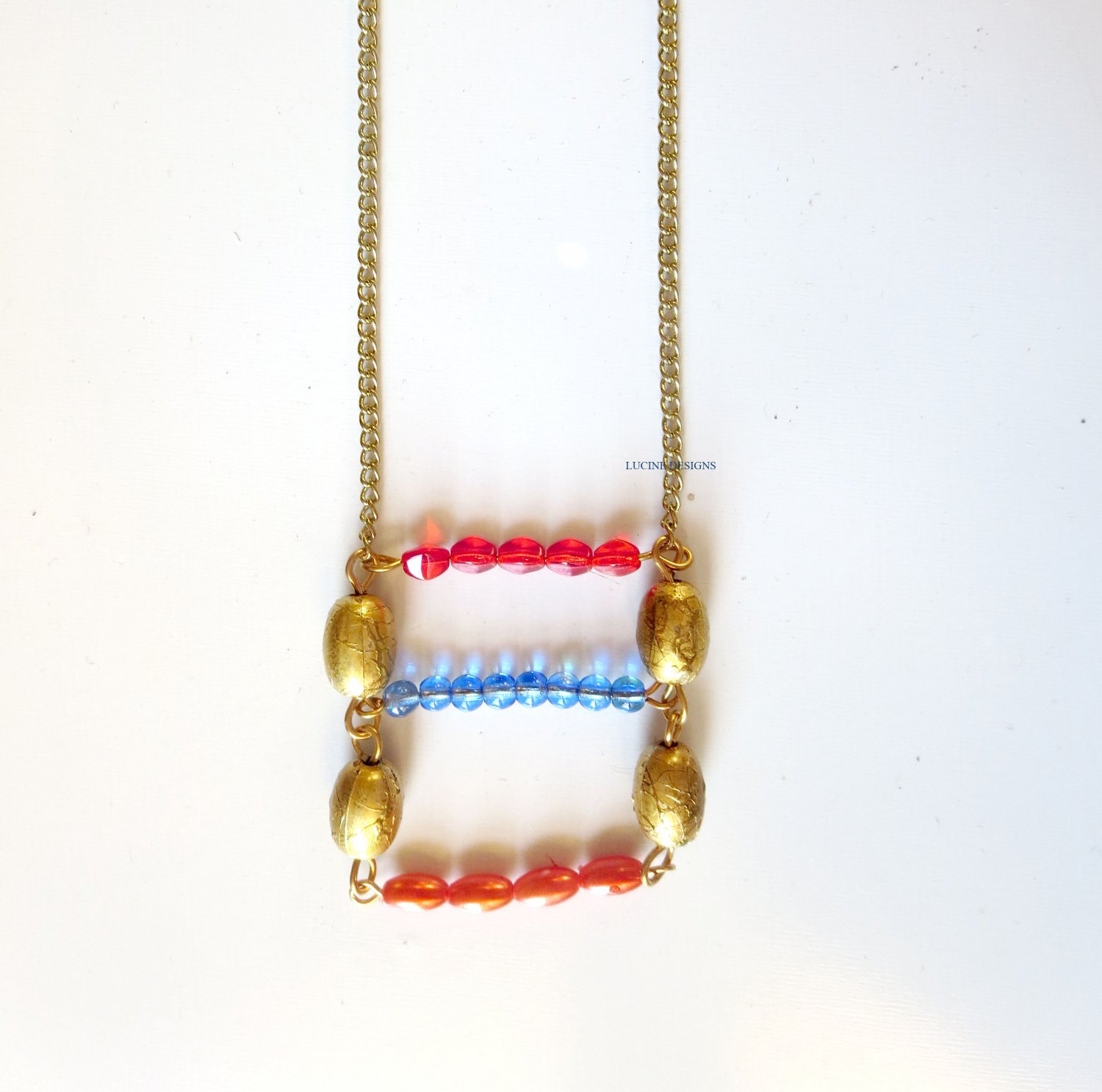 Red blue orange and gold trendy fashion necklace by Lucine