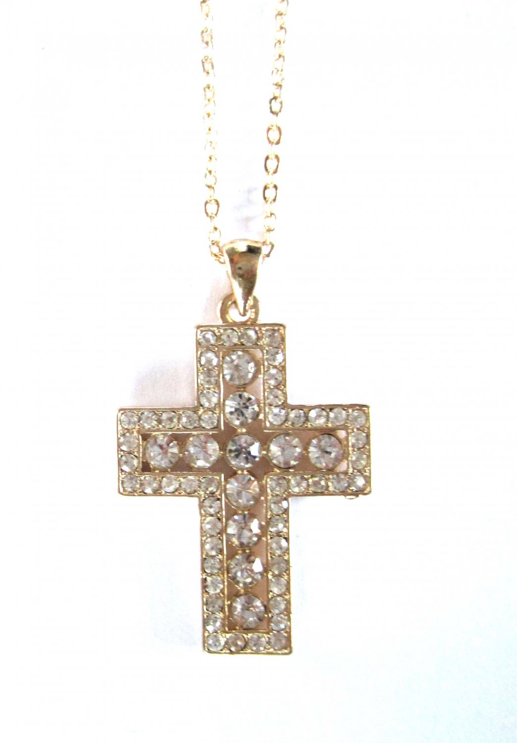 Gold cross with white crystals pendant on chain