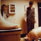 unknown color photo 8x10 of a giant foot, a pig, a woman with tissue and a man