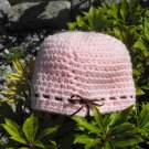 Pink Crocheted Hat with Brown Ribbon Bow