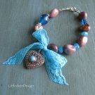 Filigreed silver heart with turquoise lace bow, lavender moukaite and Swarovski crystal bracelet