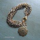 Antique gold finish metal flower peace sign pendant with multiple chains bracelet