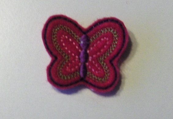 Pink felt embroidered butterfly clippies