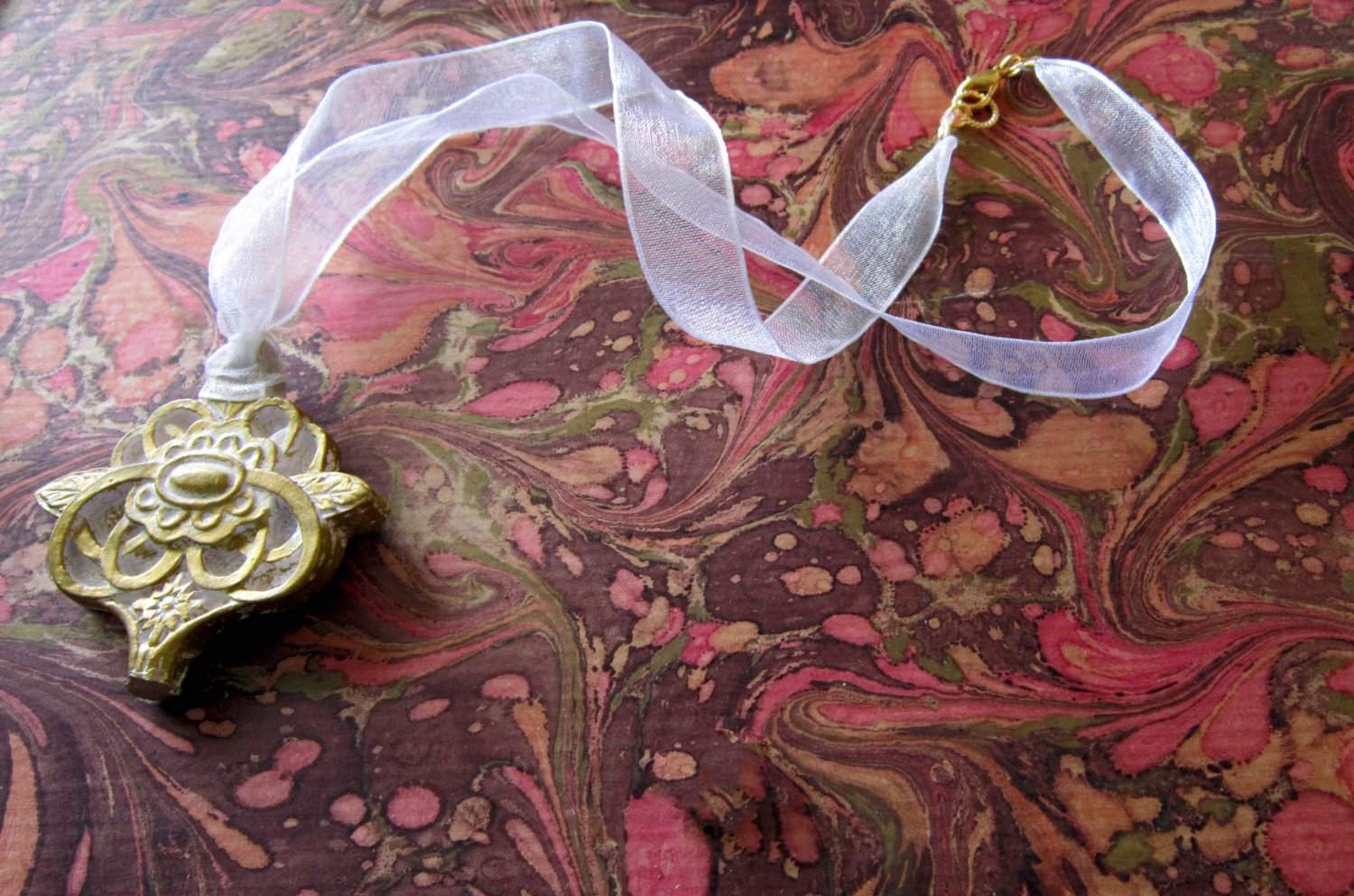 On Key: Vintage-inspired Gold Filigree Medallion White Ribbon Necklace