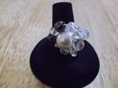 Metal glass pearl in the middle crystals and black beads around ring size 6