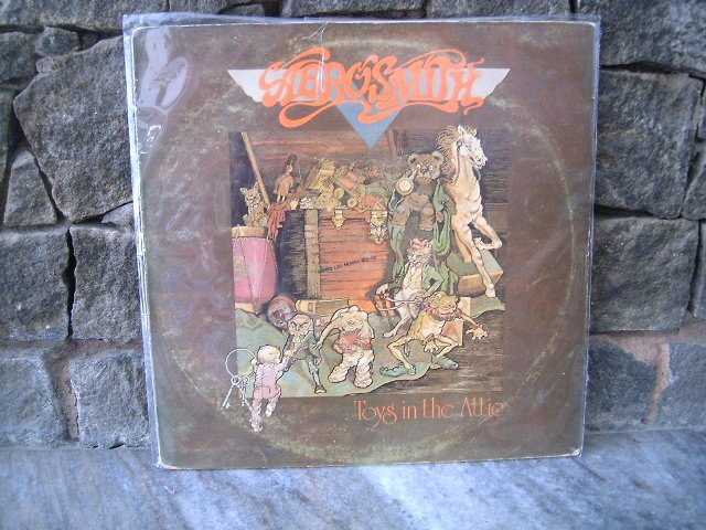 AEROSMITH Toys in the Actiom ´LP  1977 HARD ROCK MUITO  VINIL