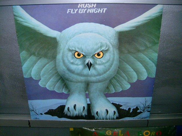 RUSH fly by night LP 1975 ROCK SEMI-NOVO MUITO RARO VINIL