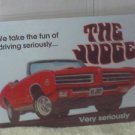 PONTIAC GTO JUDGE TIN SIGN GARAGE OR WALL DECOR
