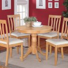 5PC ROUND DINETTE TABLE SET AND 2 FAUX LEATHER UPHOLSTERED SEAT CHAIRS IN OAK