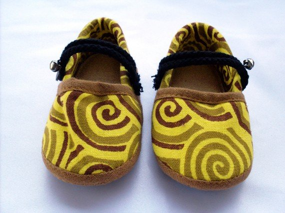 Funky colourful childrens shoes for boys or girls. Yellow and brown. Baby toddler small size