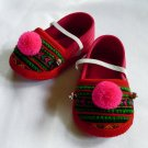 Funky colourful childrens shoes for both boys or girls. Red green pink. Baby small size
