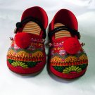 Funky colourful children&#39;s shoes for both boys or girls. Red and orange. Toddler large size