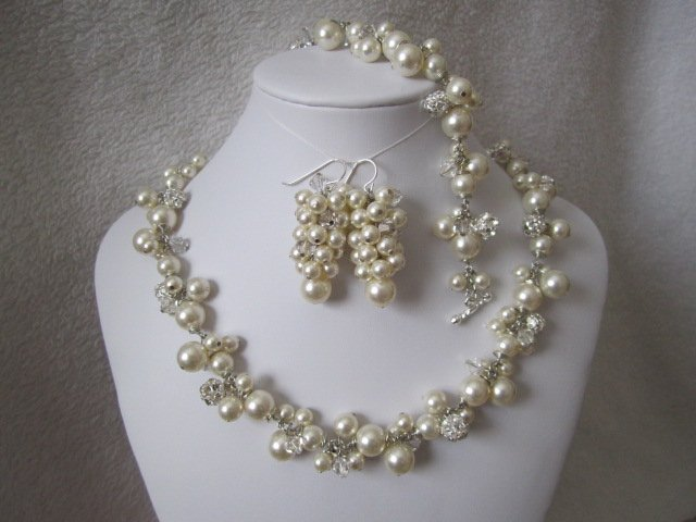 Set of bridal jewelry with earrings, necklace, and bracelet