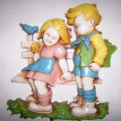 Hummel Couple Sitting On Park Bench   Wall Hangr BNK2656