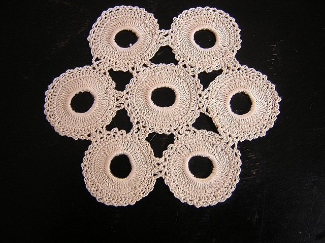 Tiny hand-crocheted doily 7 rings ecru vintage hc1676