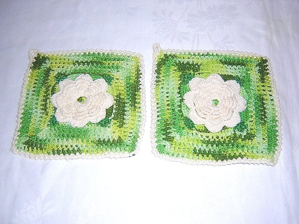 Pair of hand crocheted potholders with rose centers and hanging loops hc1313