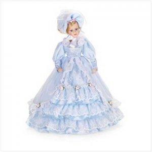 Porcelain Doll In Blue Bonnet