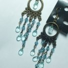 Copper tone earring with light blue crystal style dangle