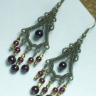 Copper tone earring dangle with red bead