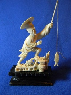 Antique pre-ban pure ivory Chinese fisherman carving on ebony wood base
