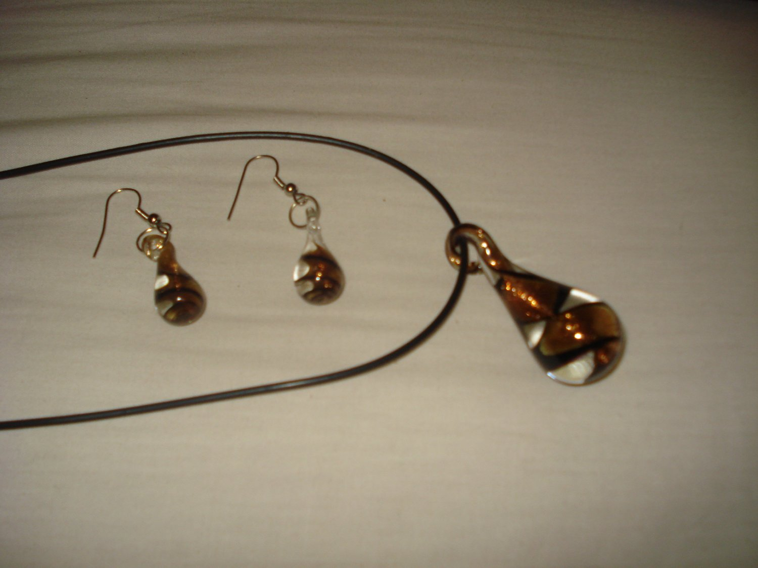 Clear glass genie bottle shaped necklace & earring set with gold and black swirls - eg10