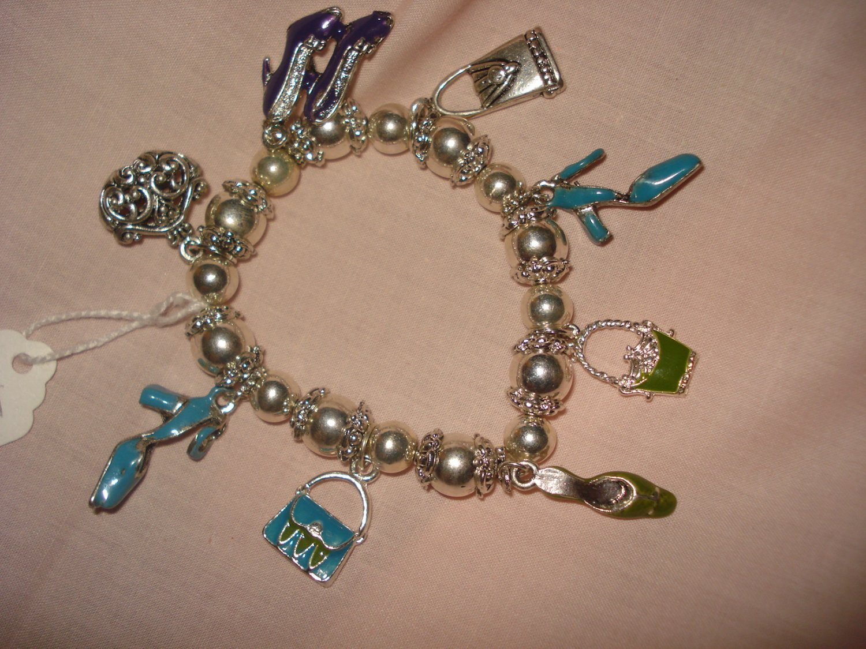 Silver stretch bracelet with enameled purse & shoe charms - eg23