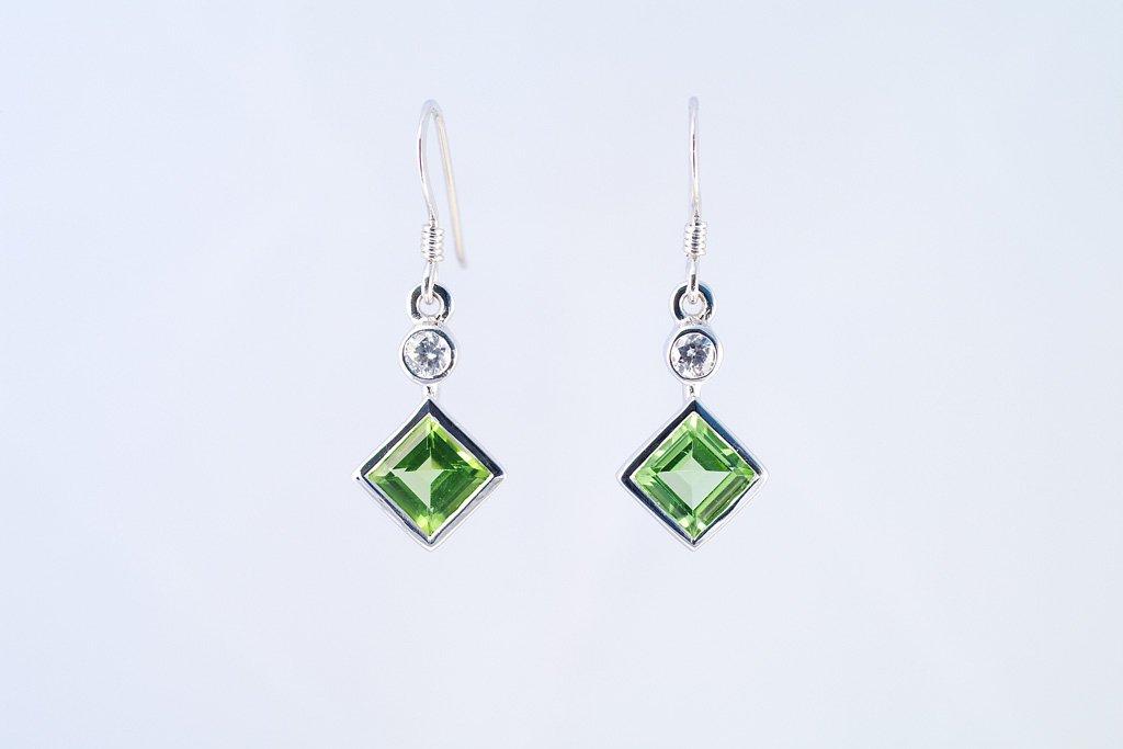 Peridot earrings w/ cz. 925 sterling silver W/G plated