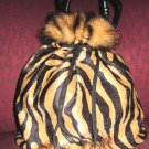 Zebra like drawstring mini purse