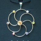 Sterling Silver Circle Pendant Accented with Cubic Zirconia Gems.