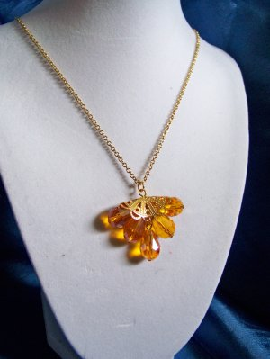 Gold crystal fan necklace