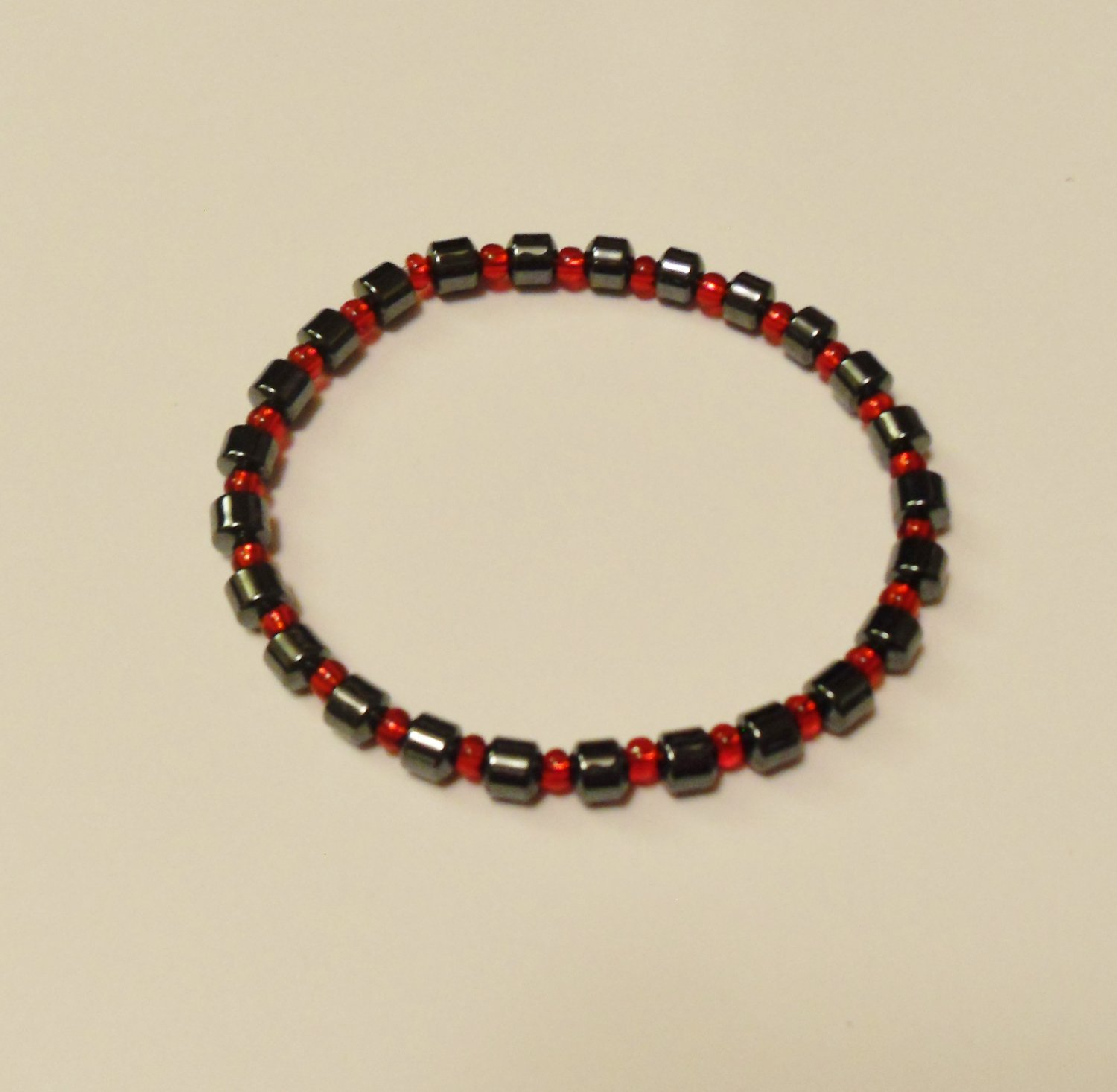 Hematite and clear red surfer bracelet