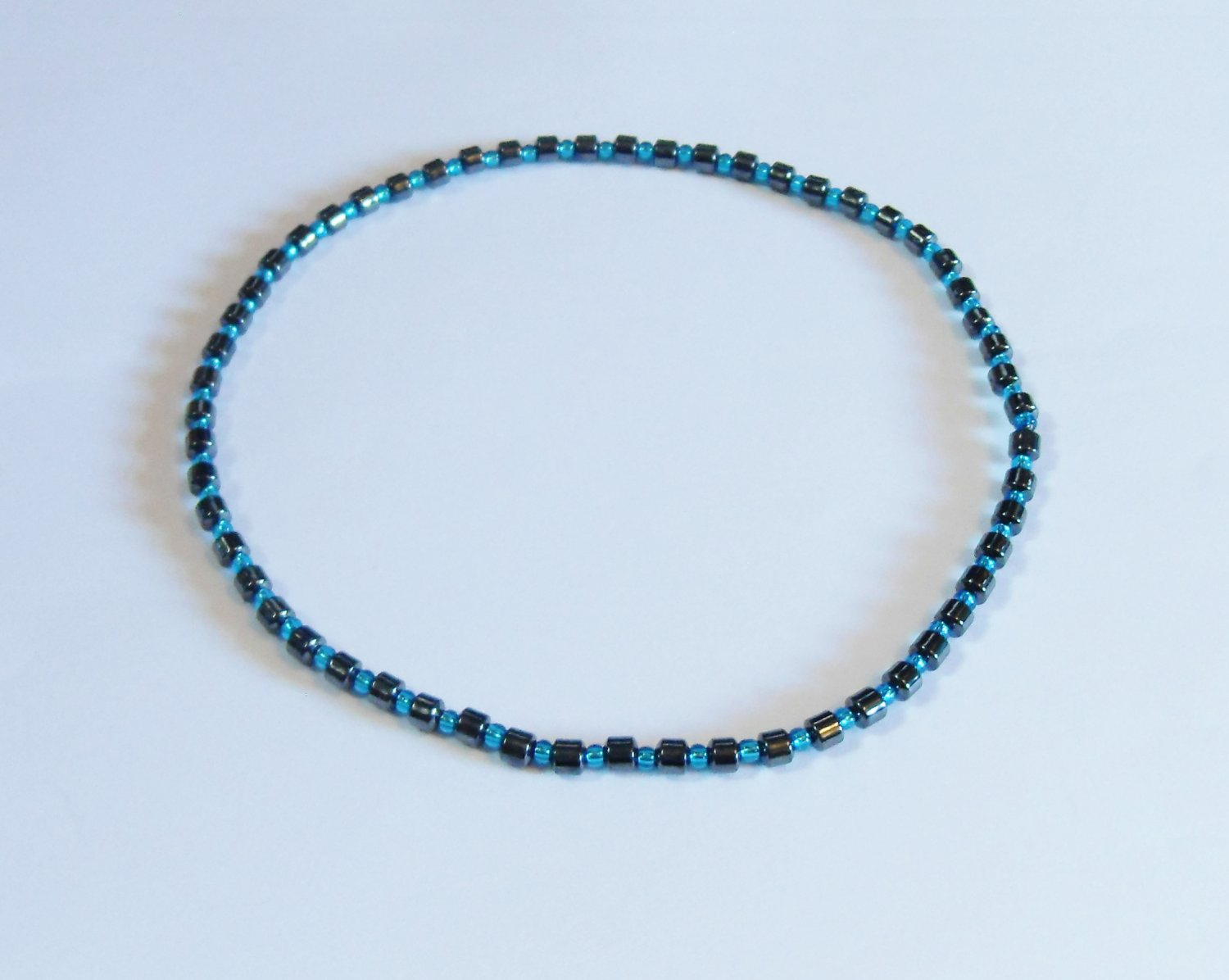 Hematite drum and clear blue stretchy surfer necklace