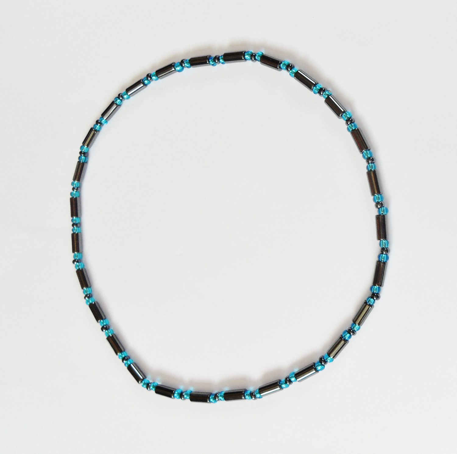 Long drum hematite and clear blue stretchy surfer necklace