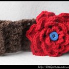 Crocheted headband with large red flower