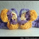 Crocheted headband with butterfly