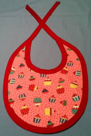 Cupcake And Yellow Bib With Red Ties