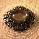 Silver Tone Brooch Pin Clear Center